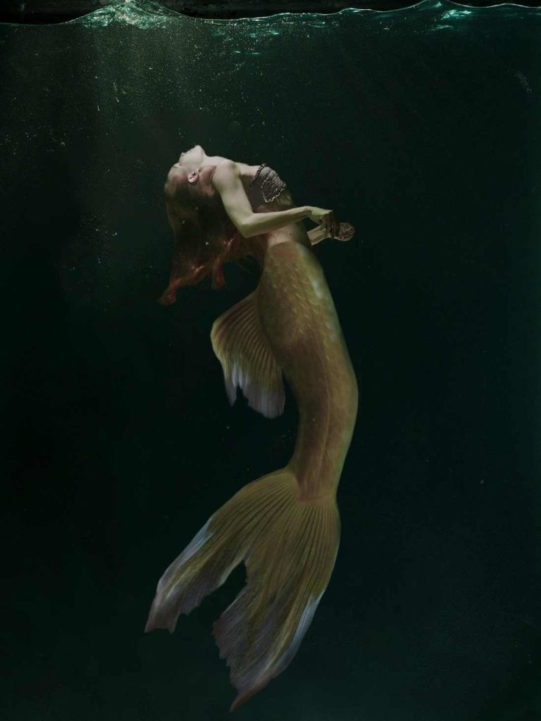 A depiction of a mermaid or a siren in deep water